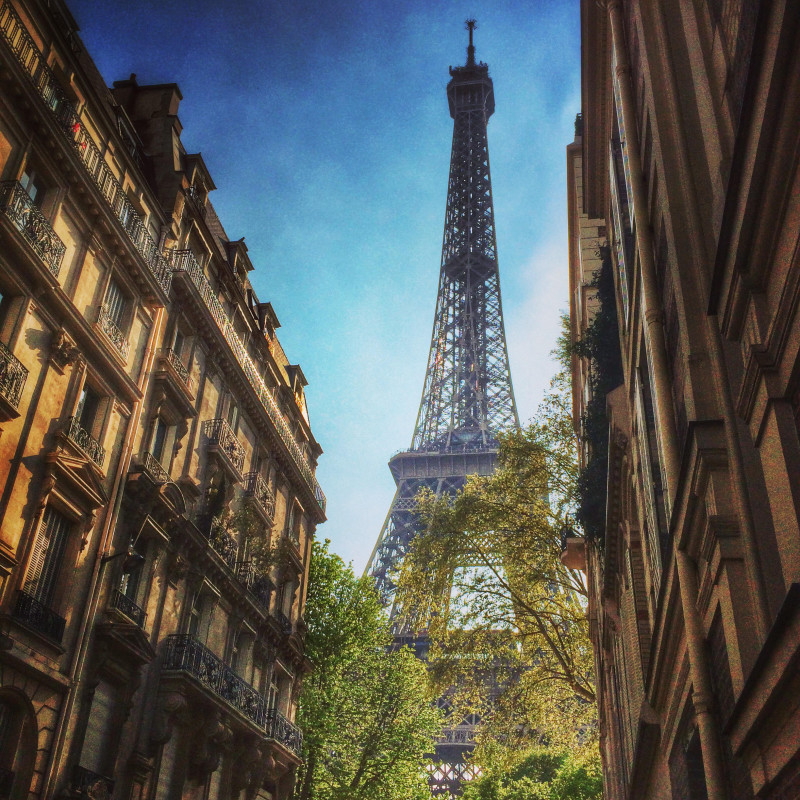 France, Paris, Eiffel Tower seen in between townhouses